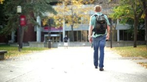 stock-footage-college-student-walking-on-a-university-campus